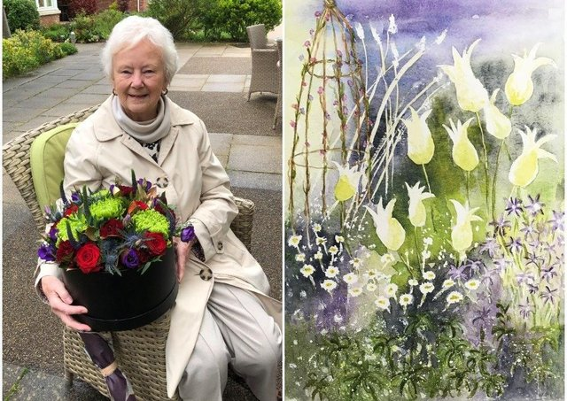 Jean Allen was presented with a bunch of flowers by Richmond Villages Northampton after her painting made the front cover of a poetry book by charity NAPA (National Association for People Providing Activities) NNL-211006-114031001