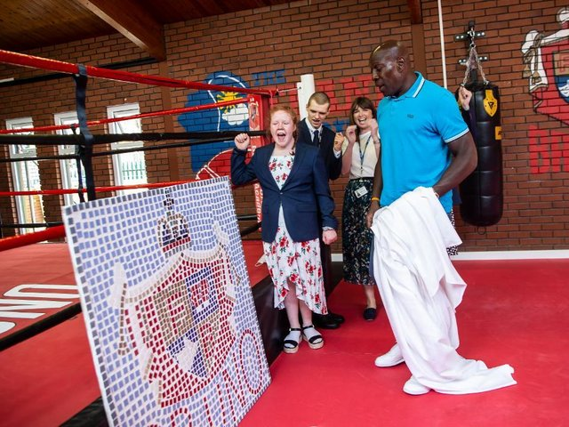 Frank Bruno unveils Isebrook School's mosaic with pupils and teachers at The Round by Round Centre in Northampton