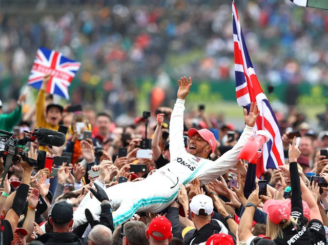 Lewis Hamilton celebrates his Silverstone victory in 2019 by crown-surfing
