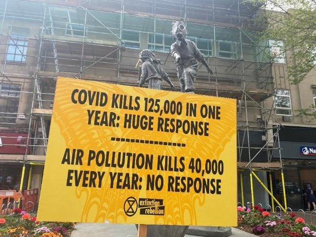 Extinction Rebellion put up posters around the iconic statue in Abington Street