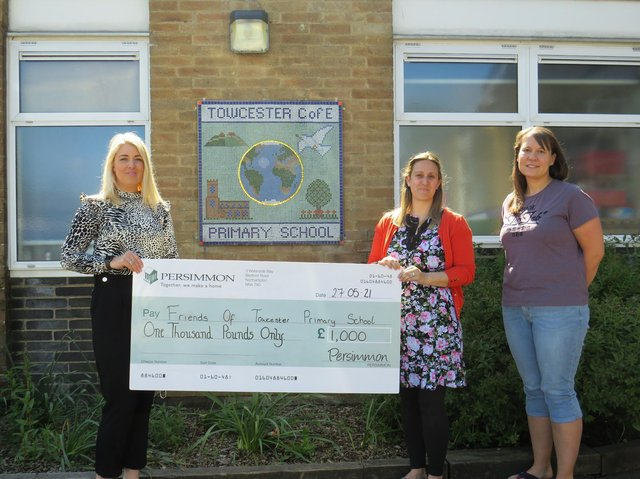 Friends of Towcester Primary School accepting the donation from Persimmon Homes.