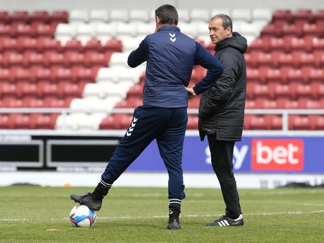 Colin Calderwood, pictured working for Blackpool, and Ian Sampson are now on the same team.