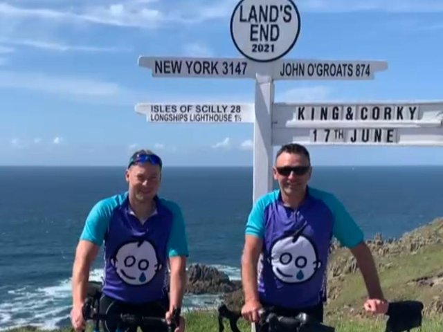 Ian Corkram and Jeff King at Lands End having cycled from Milton Keynes for Great Ormond Street Hospital