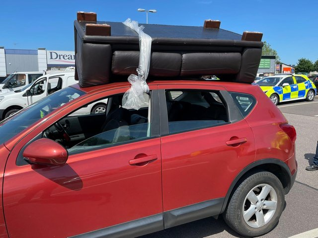 Police found the sofa tied with plastic to the top of a car