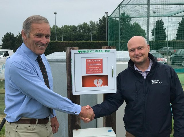 Towcester Sports and Social Club chairman Frank Osbourne (left) and Taylor Wimpey South Midlands production director Kevin Salisbury with the new defibrillator