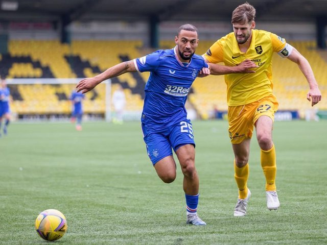 Jon Guthrie battles with Rangers player Kemar Roofe whilst playing for Livingston.