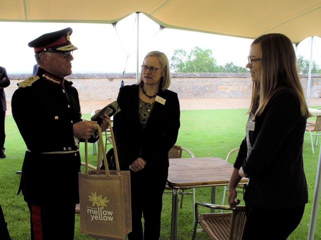 Rachel Lindsay and Gina Lewis of Queen's Award for Enterprise winners Farrington Oils with Lord-Lieutenant of Northamptonshire James Saunders Watson at Rockingham Castle