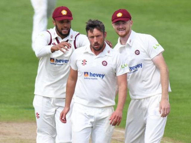 Simon Kerrigan is congratulated by Emilio Gay (left) and Tom Taylor after claiming one of his four wickets against Yorkshire
