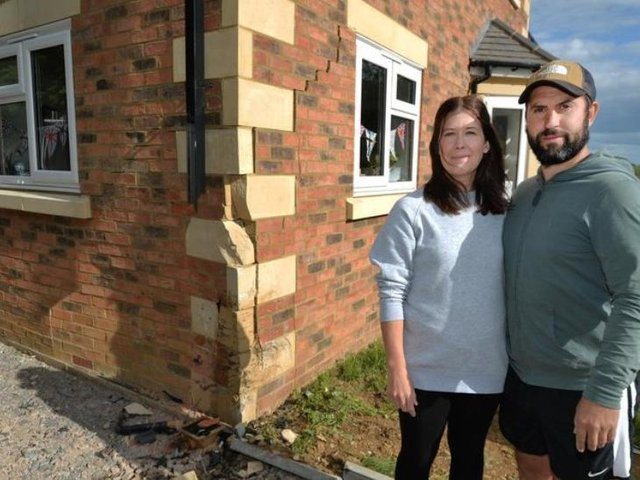 Katie and Jack Walther with their damaged home. Image: Andrew Carpenter.
