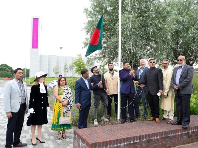 The Bangladeshi flag is raised surrounded by dignitaries at the event to celebrate 50 years of the country's indepedence at the University of Northampton's Waterside campus