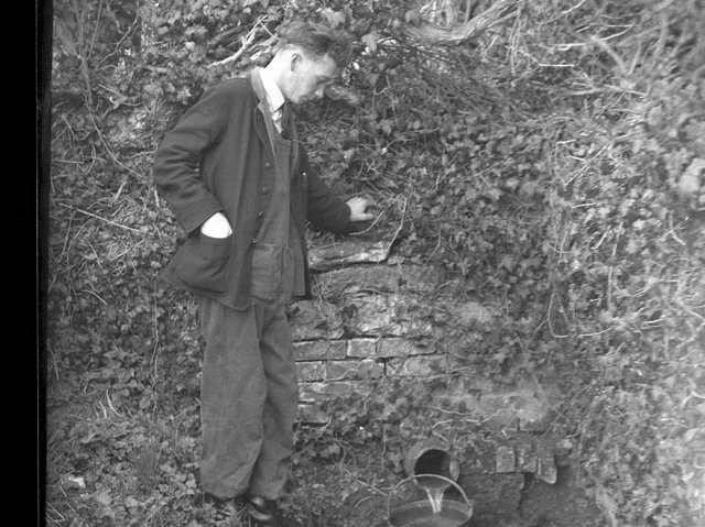 Mr Dilks fetches water from the stream in Dodford.
