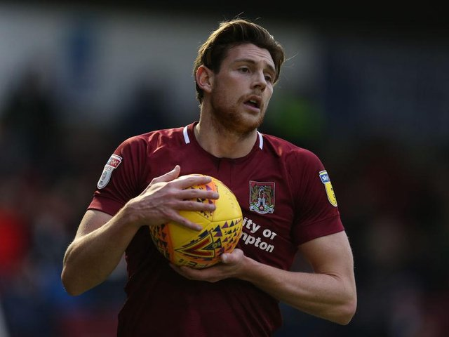 Ash Taylor spent two seasons at Sixfields.