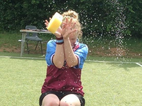 Boughton Primary School reception teacher Nicola Cook gets hit with a wet sponge during the 'soak a teacher' contest