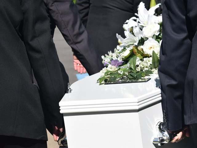 A crematorium has urged families not to leave personal belongings in coffins.