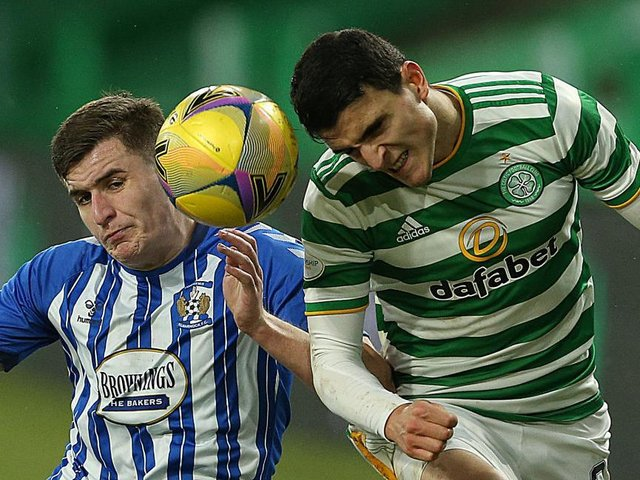 Aaron McGowan, playing for Kilmarnock, challenges for a header with Celtic's Mohamed Elyounoussi in the SPL last season. Picture: Getty.