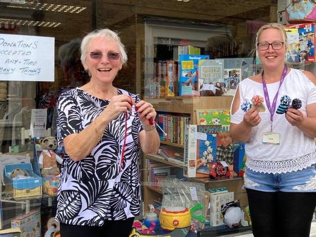 Margaret Wride (left) with manager of Age UK charity shop in Rothwell, Natasha McAlindon (right).