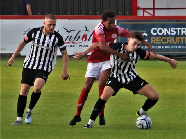 Action from Brackley Town's opening pre-season friendly against Corby Town. Picture by David Tilley