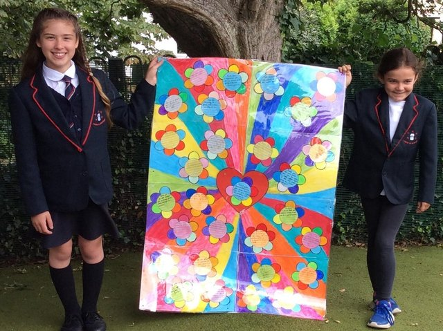 Students show off some of the artwork.