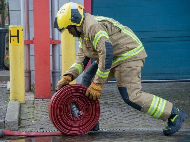A hose reel was used to extinguish the fire in the refuse lorry.