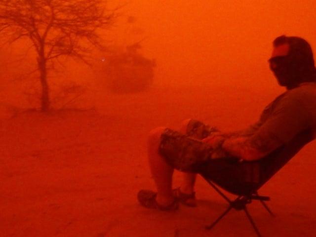A soldier sat in a sandstorm